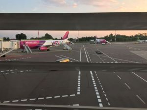 View out of the terminal onto the Wizzair A230's